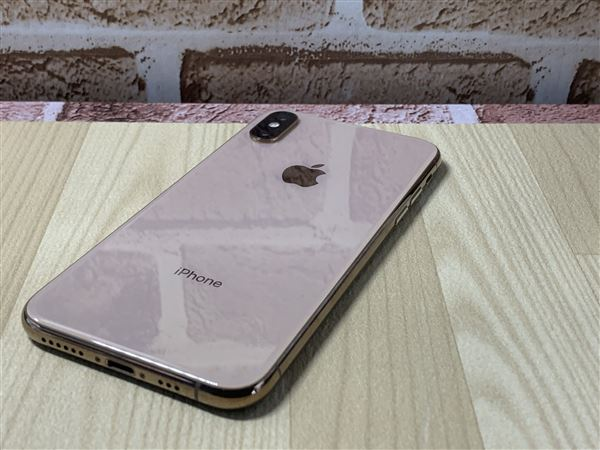 【中古】【安心保証】 iPhoneXS[64GB] SIMロック解除 au ゴールド